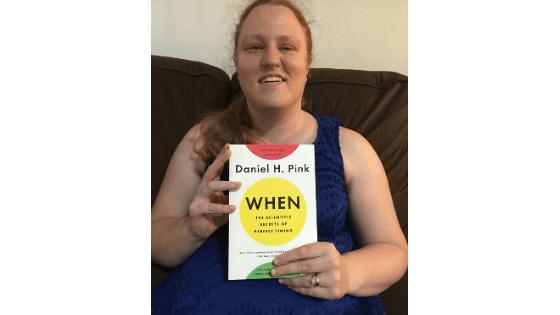 "Katie Corbett holds the book ""When"""