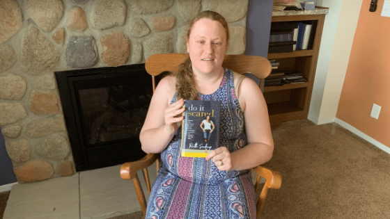 "Katie Corbett holds the book ""Do It Scared"""