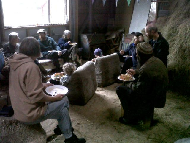 Enjoying a good chat over a bring and share lunch, in the red barn