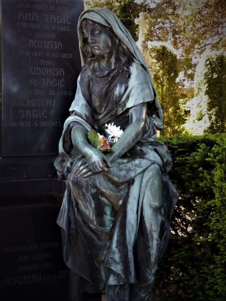 statue of woman mourning at Varaždin cemetery croatia