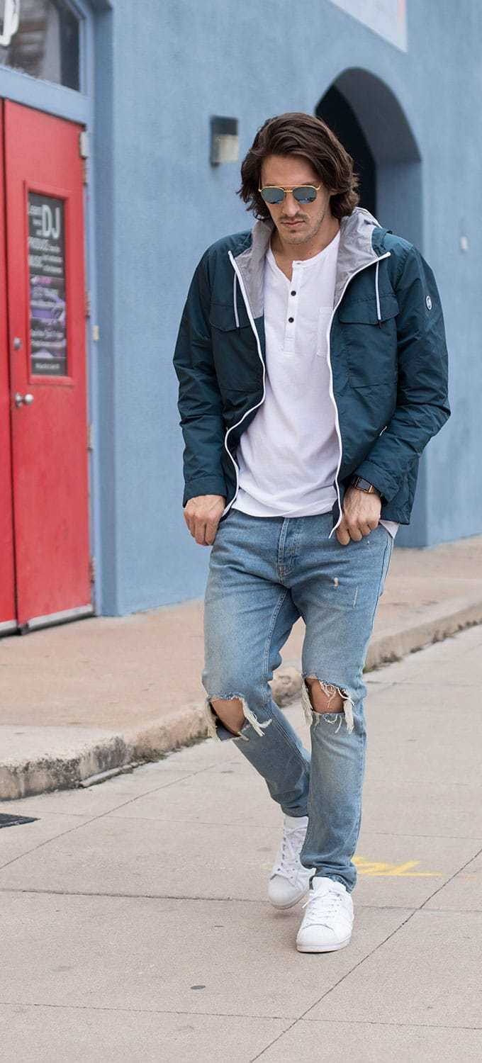 Distressed Jeans, White Henley, Blue Rain Jacket, White Sneakers