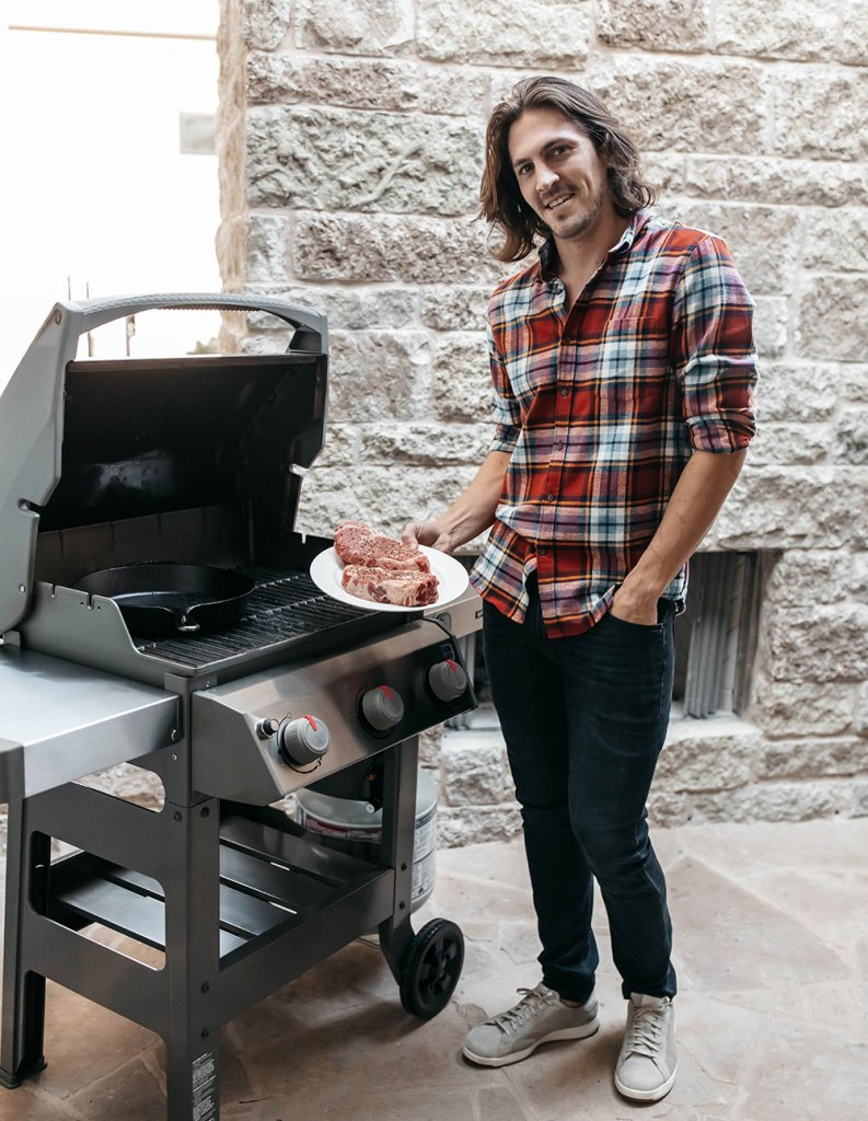 Dylan with Weber Grill and Rib Eye Steaks