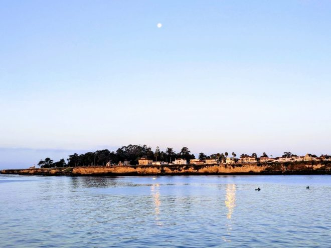 View of the point to the west of the Santa Cruz municipal wharf, with a full moon in the sky