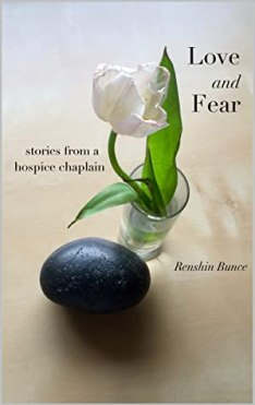 Book cover image, with a photo of a round black rock next to a small bud vase containing a single white flower with two leaves, on a plain beige table.