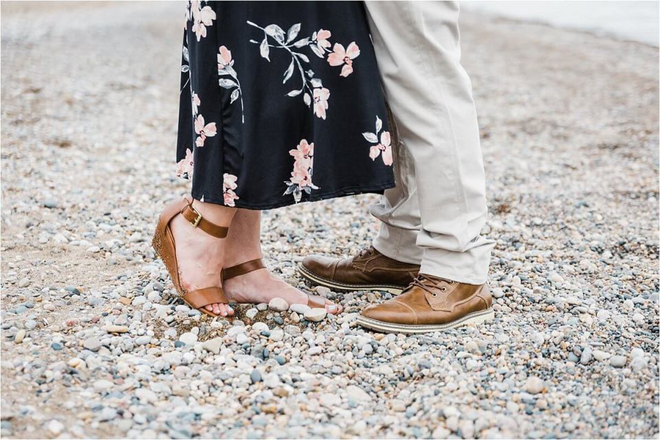 girl in leather strappy wedge shoes and boy in leather brown shoes on beach shore - London Stratford Cambridge Woodstock Wedding Photographer by Dylan and Sandra of Dylan Martin Photography