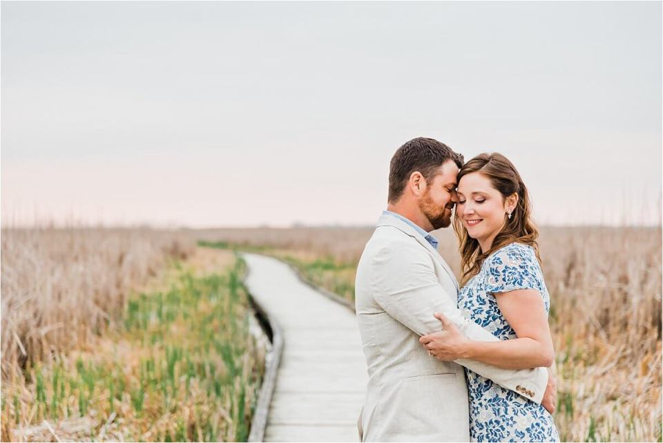 couple hugging on the boardwalk at point pelee - London Stratford Cambridge Woodstock Wedding Photographer by Dylan and Sandra of Dylan Martin Photography - London Stratford Cambridge Woodstock Wedding Photographer by Dylan and Sandra of Dylan Martin Photography