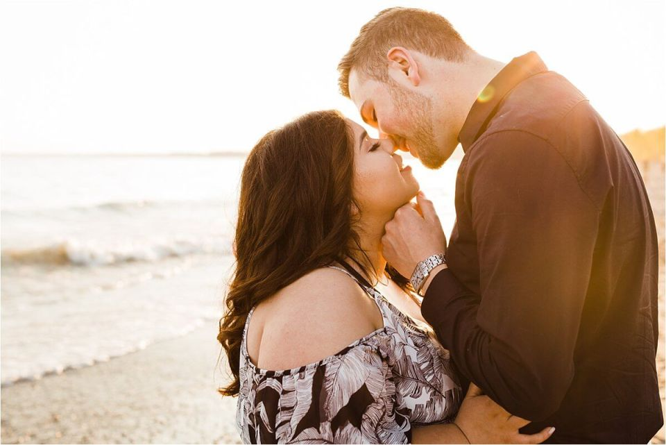 man and woman kissing on the beach at sunset with golden light - London Stratford Cambridge Woodstock Wedding Photographer by Dylan and Sandra of Dylan Martin Photography