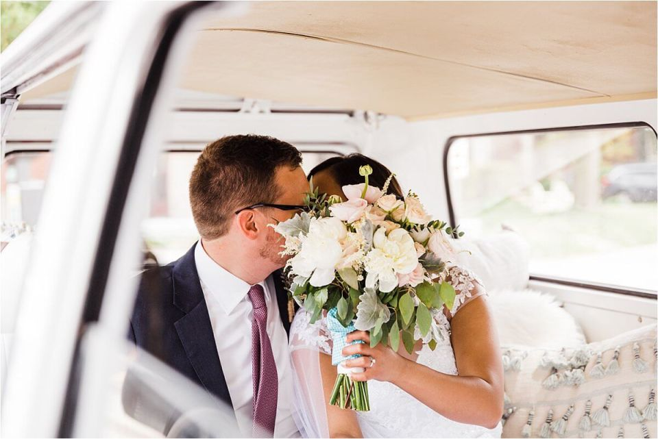 bride and from kissing behind bouquet I their getaway car - Dylan and Sandra of Dyan Martin Photography for Weddings and Engagement candid photographer in London, Cambridge, Stratford and Woodstock Ontario