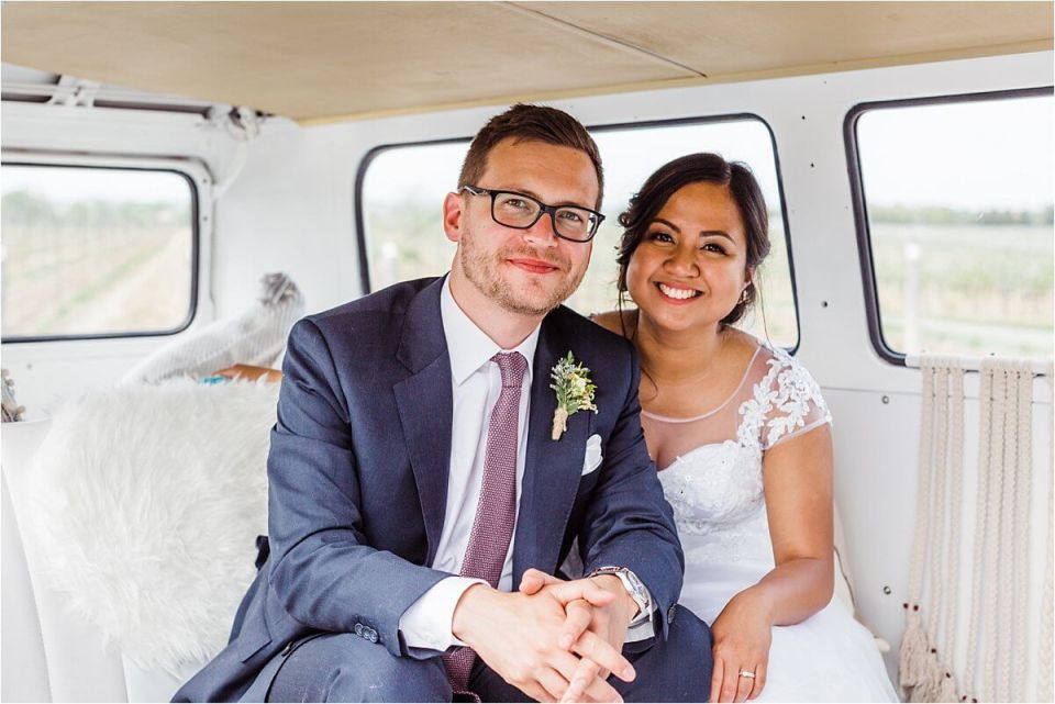 bride and groom smiling on their wedding day in their Volkswagen kombi - Dylan and Sandra of Dyan Martin Photography for Weddings and Engagement candid photographer in London, Cambridge, Stratford and Woodstock Ontario