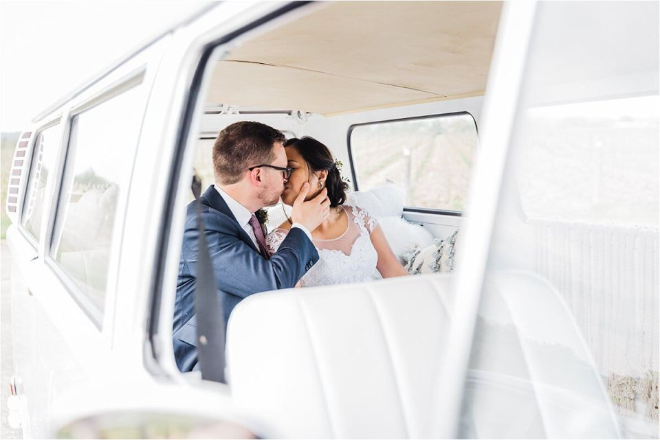 bride and groom kissing in their getaway vw kombi - Dylan and Sandra of Dyan Martin Photography for Weddings and Engagement candid photographer in London, Cambridge, Stratford and Woodstock Ontario