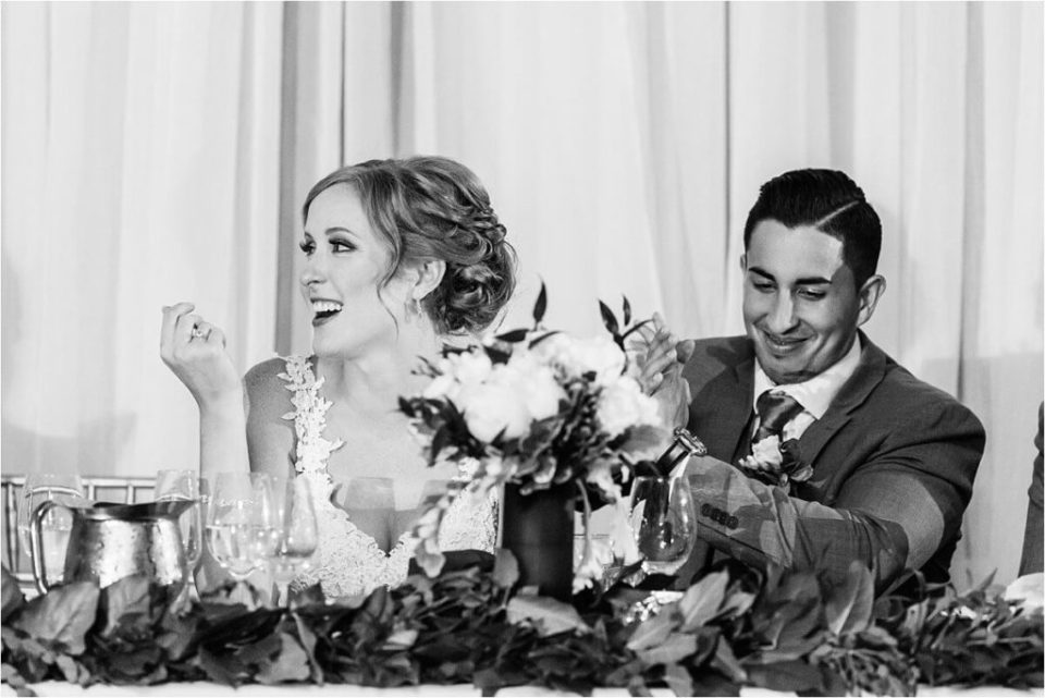 Bride and groom celebrate and laugh at their London Ontario wedding reception