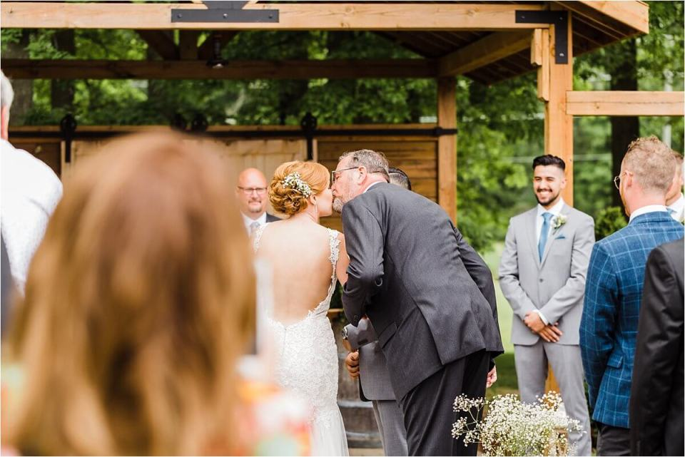 Father of the bride hands off his daughter during this outdoor st Catherines wedding at Club Roma