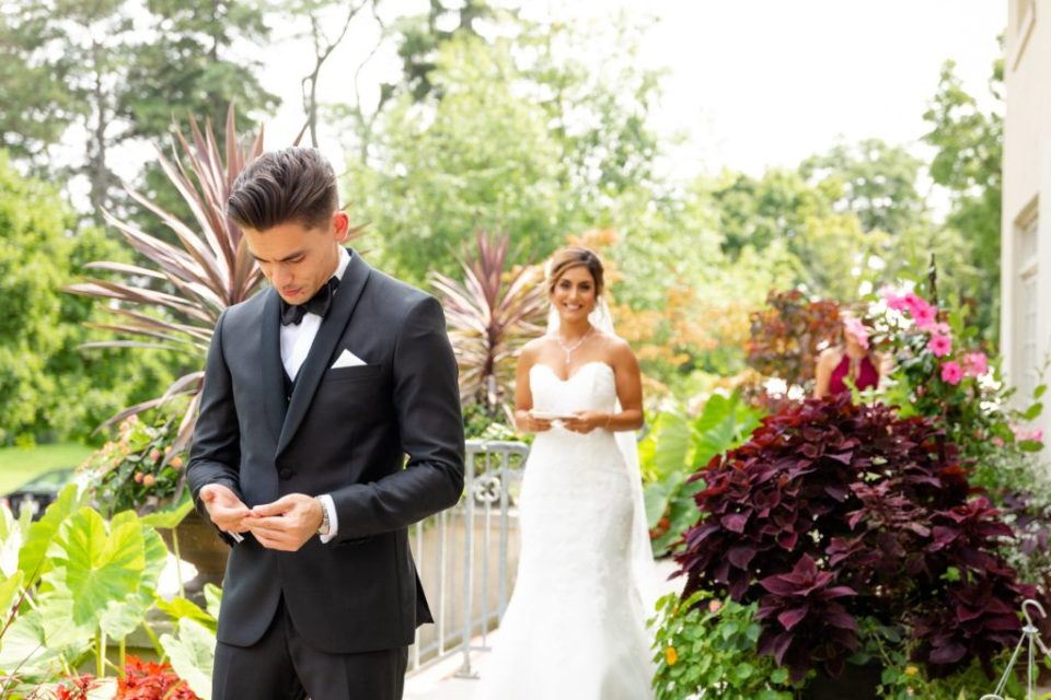 A bride and groom have a first look on their wedding day at Elsie Perrin Williams Estate in London Ontario