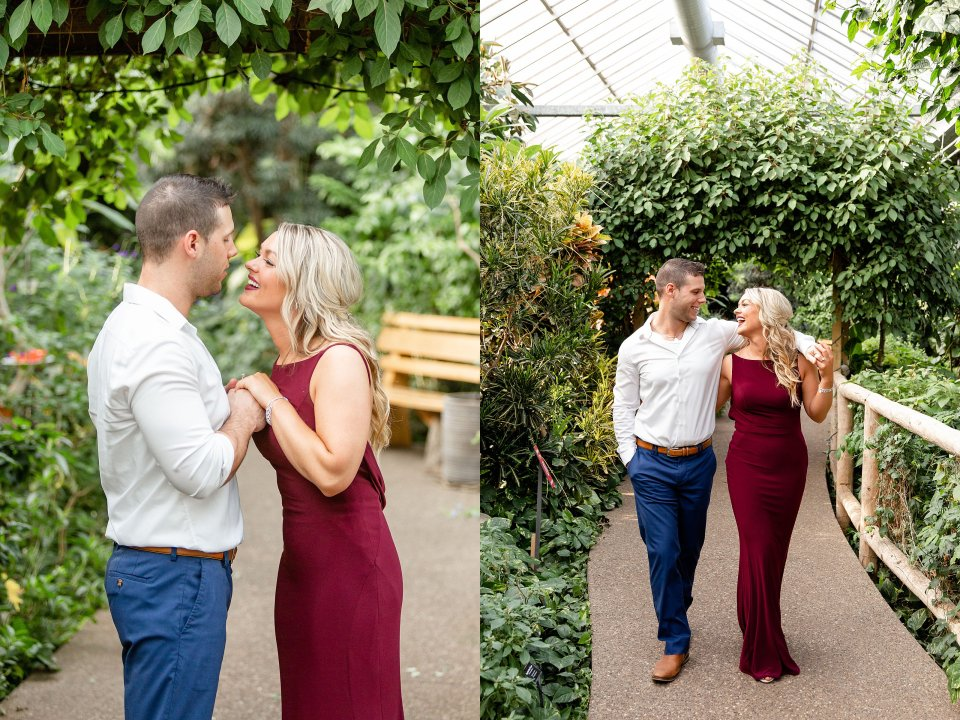 Beautiful couple walking in a butterfly conservatory