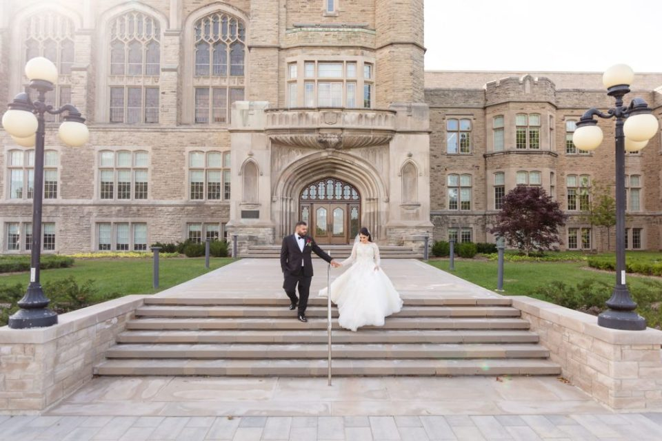 Bride and groom walk together down the steps at Western University Campus in London Ontario
