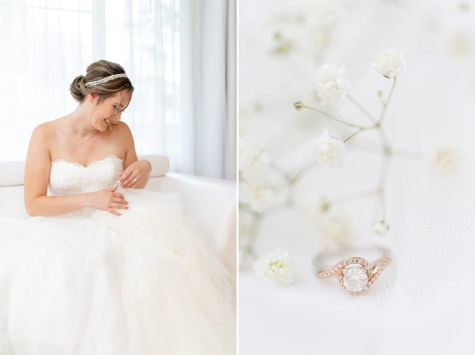 Bride sitting on a white couch admiring her wedding dress and savouring the moments