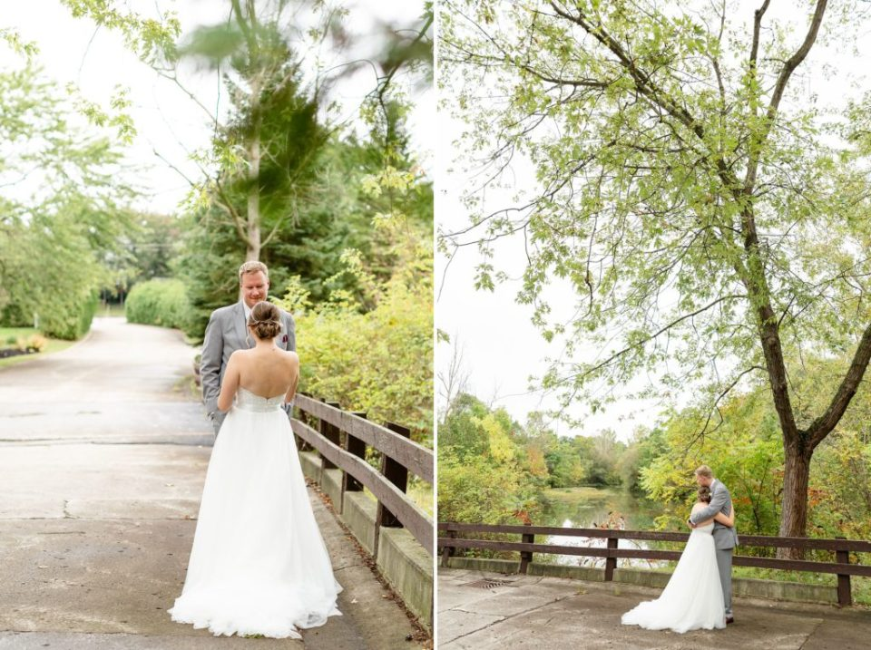 Bride and groom standing under a large tree on the bridge during their gorgeous Autumn Ukraina Country Club Wedding