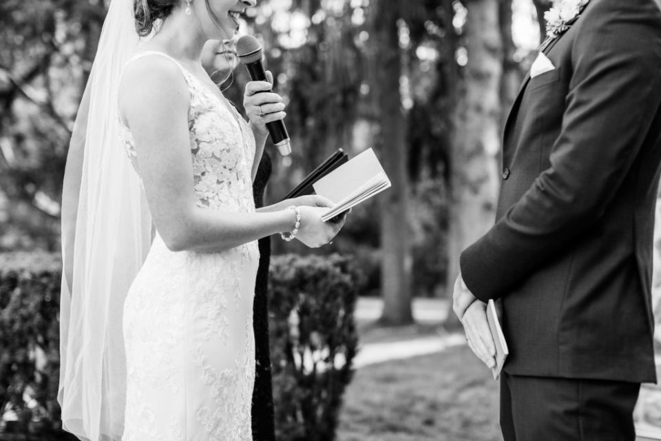 Bride and groom exchange vows during their outdoor Windermere Manor ceremony