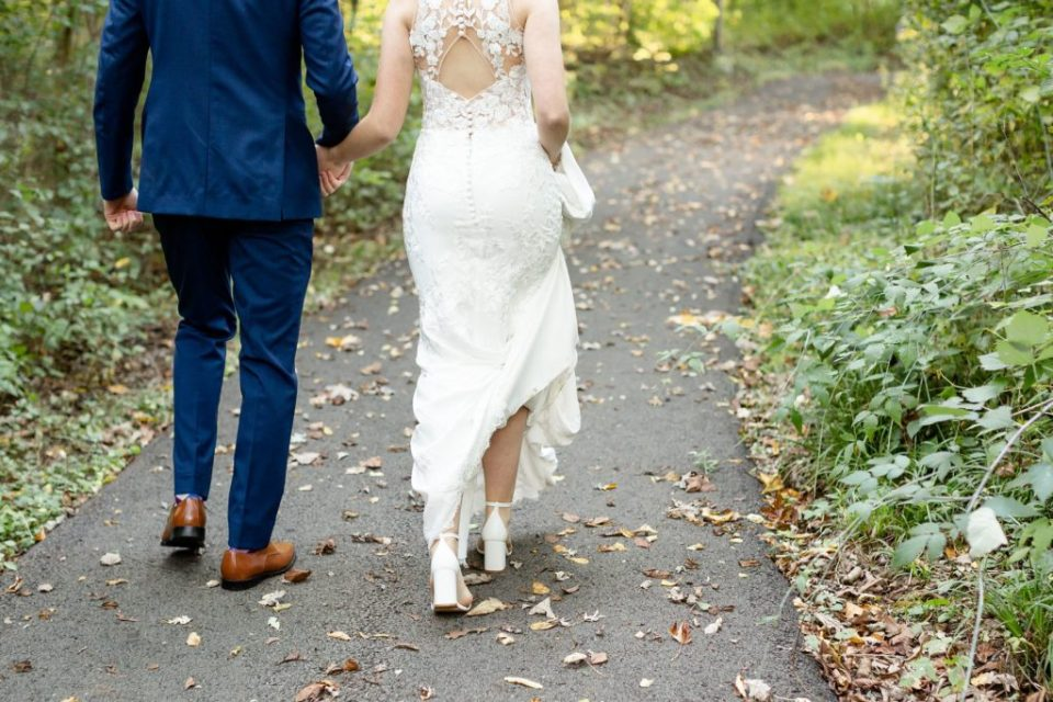 Bride and groom walking back to Windermere Manor for their wedding reception