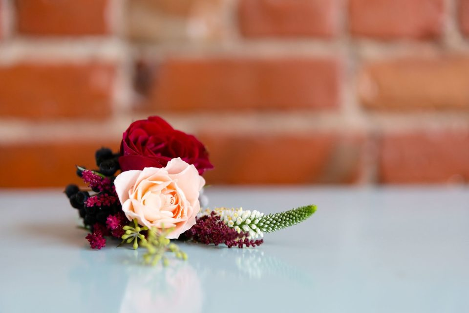 Boutonniere at a great gatsby themed wedding taken at Retro Suites Hotel in Chatham