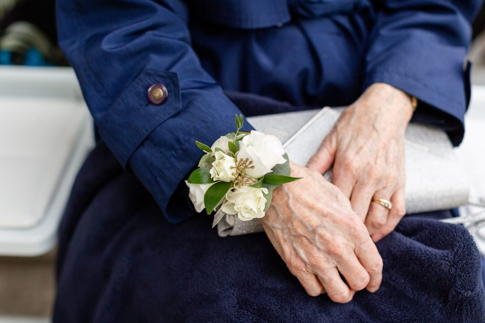 Grandmother of the Bride wearing a corsage on her grandson's wedding day.