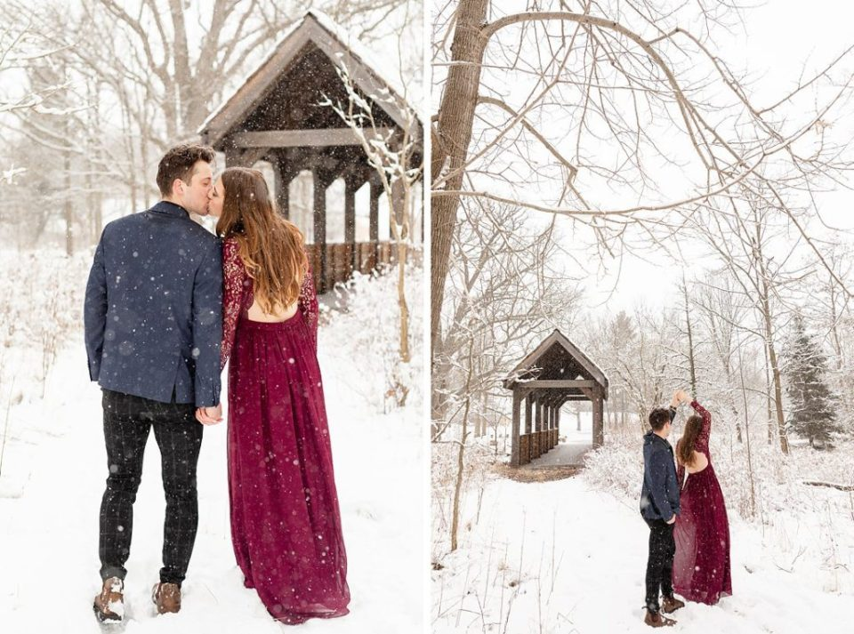 couple dancing in the snow for their engagement session at Sydenham Ridge estates