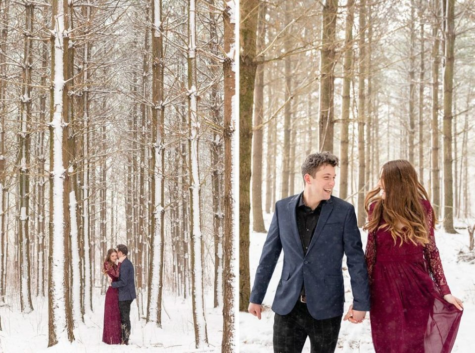 Couple having fun and laughing at their engagement session in a pine tree forest