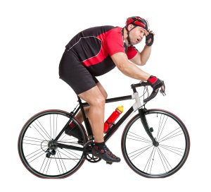 Fat guy on a bike having a hard time