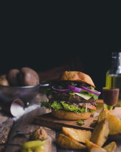Beautiful hamburger and home fries. Photo by Pablo Merchán Montes on Unsplash