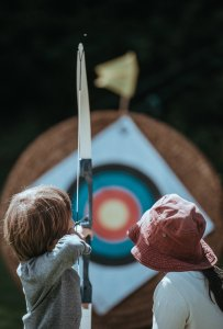 Two child playing arrow: Photo byAnnie SprattonUnsplash. Find Purpose in Life. Create a Plan. Document Lessons Learned. Commit to Continuous Improvement.