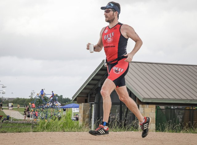 Dylan Cornelius begins the 5k run leg of the Lake Pflugerville Triathlon, June 16, 2019.