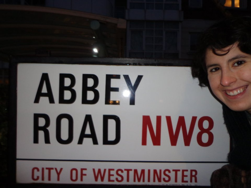 A white, black and red sign announcing the street as Abbe Road
