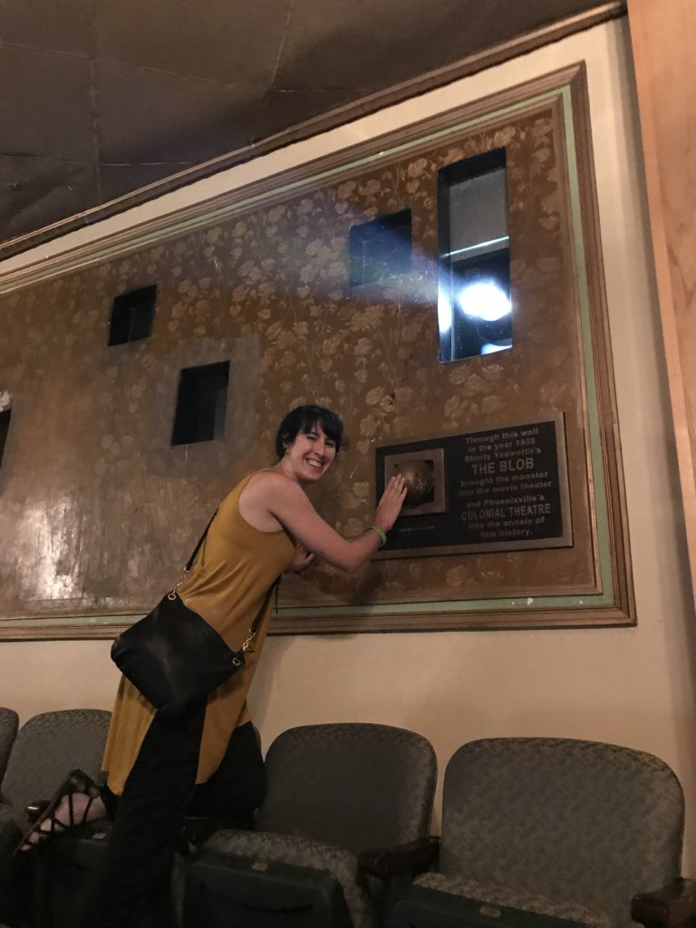 Standing next to a plaque at the back of the Colonial Theater that shows where the Blob supposedly seeped into the Theater