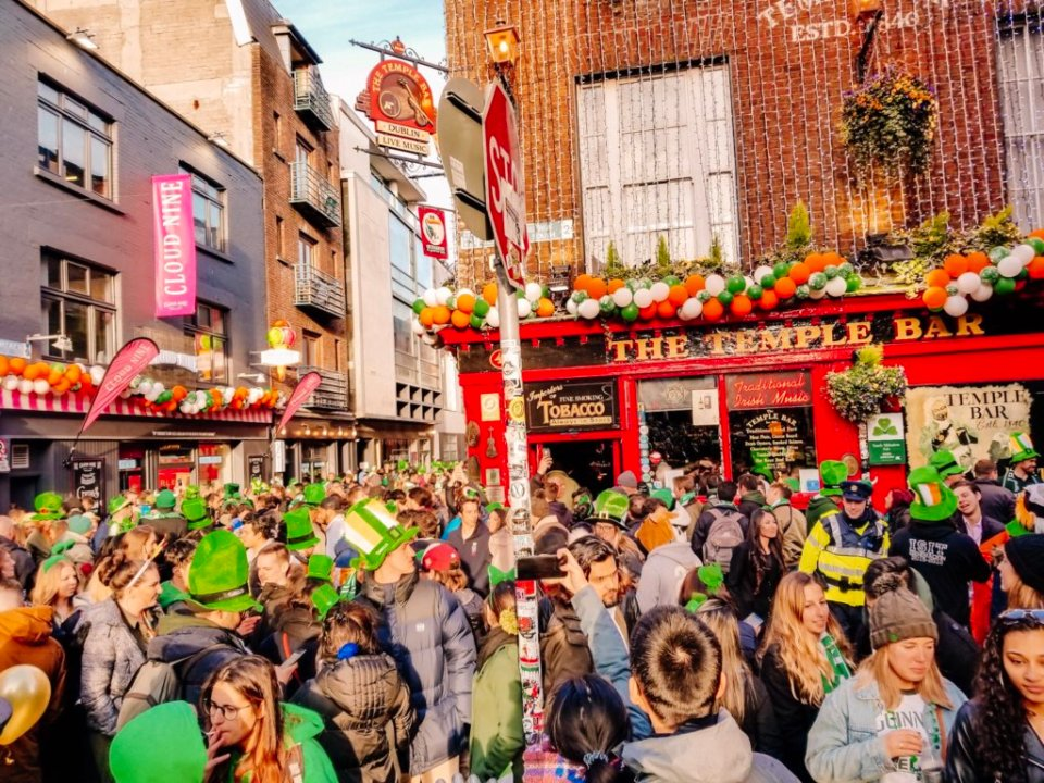 Hoards of people in Temple Bar after the St. Patrick's Day parade in Dublin Ireland
