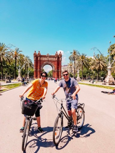 Posing with our bikes from the Bike Tour Barcelona, which was an important piece of our Spanish travel guide