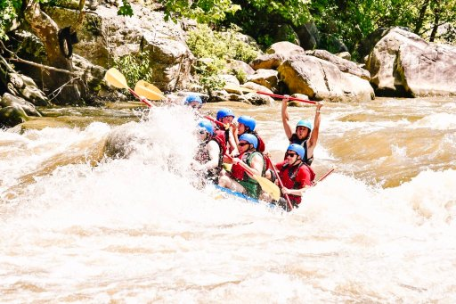 A boat full of people white water rafting on the Youghiogheny River