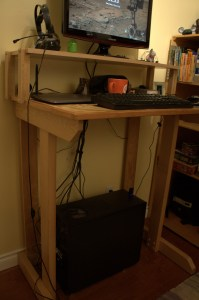 We made a standing desk out of processed trees. The result is modest, but I'm happy with it! Dads are great.