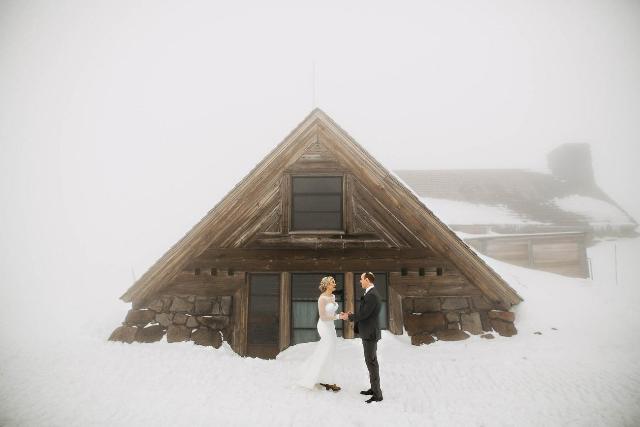 snow first look winter wedding photo