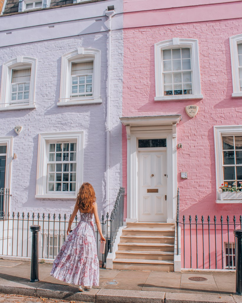 Girl in front of colourful houses