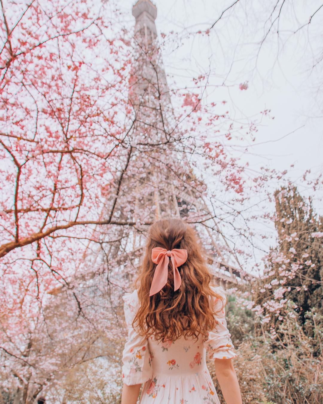 Girl beneath the Eiffel Tower