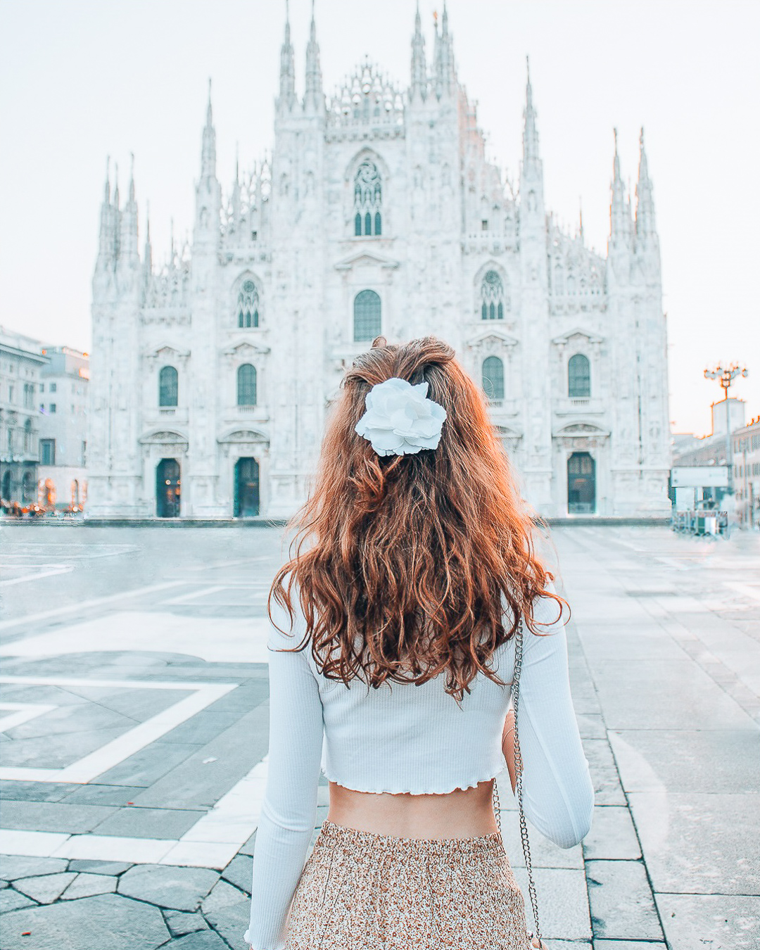 Girl in front of Duomo Milan