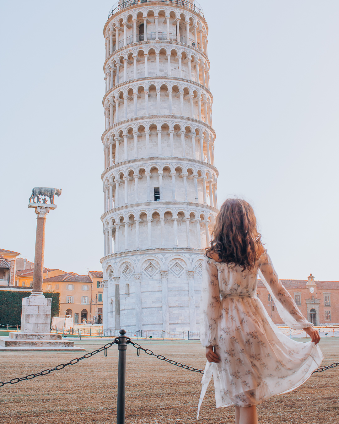 Girl in front of Tower of Pisa