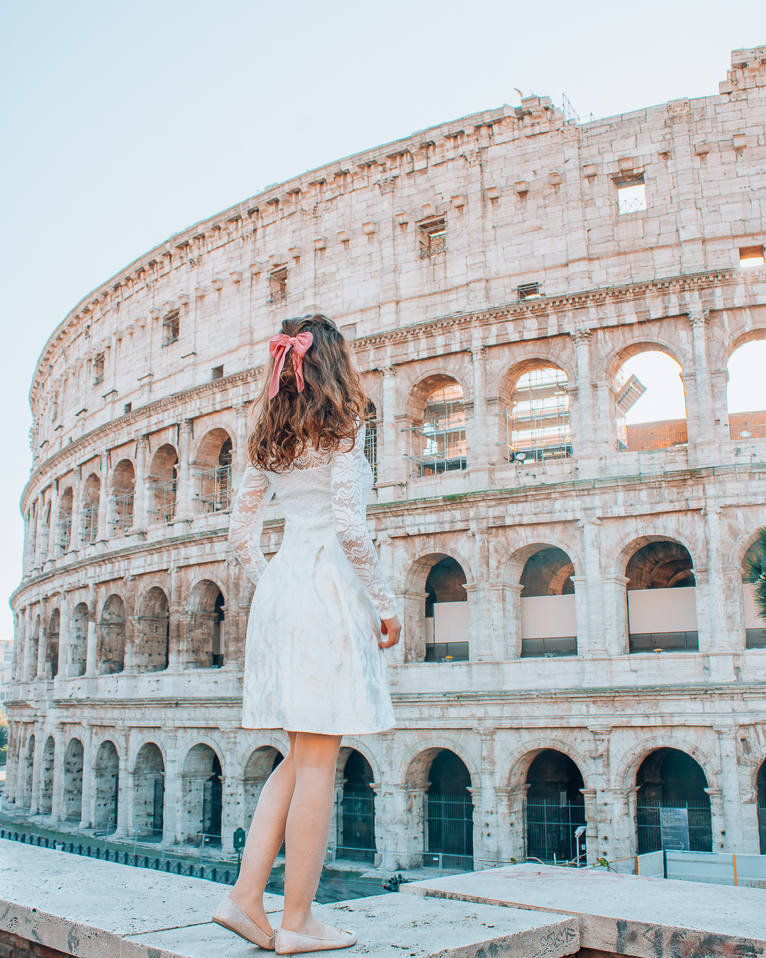 Girl in front of Colosseum