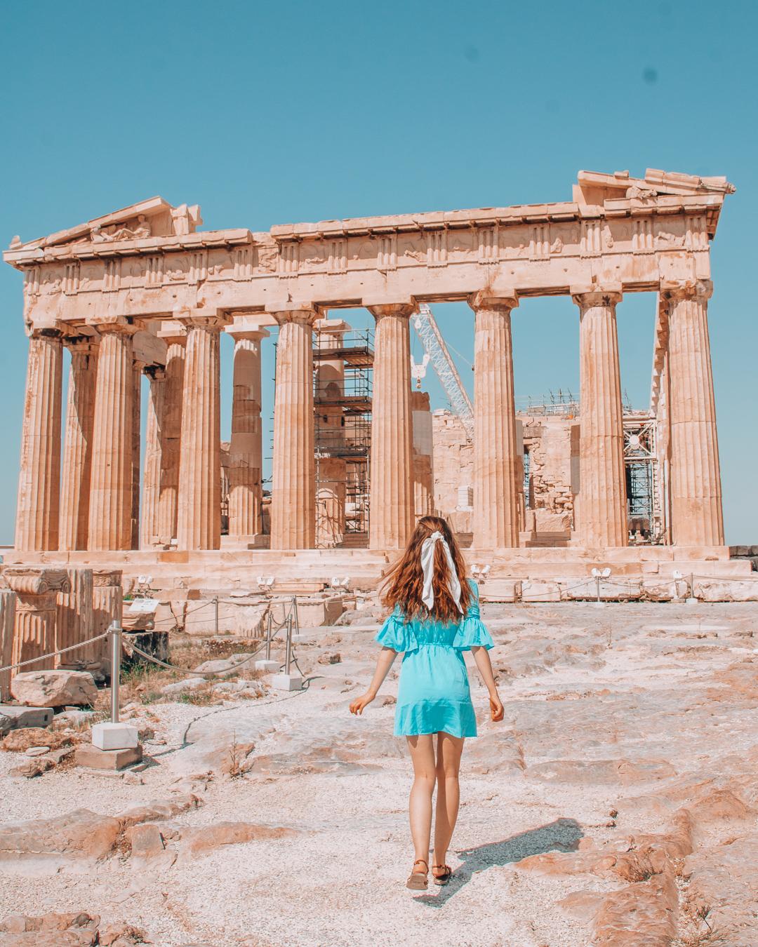Girl running towards the Parthenon