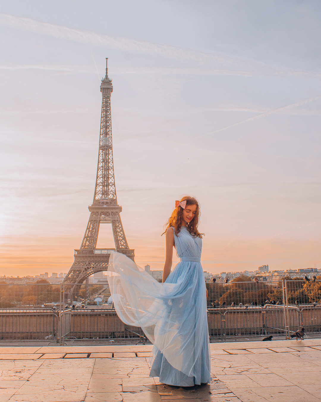 Swirling dress in front of the Eiffel Tower