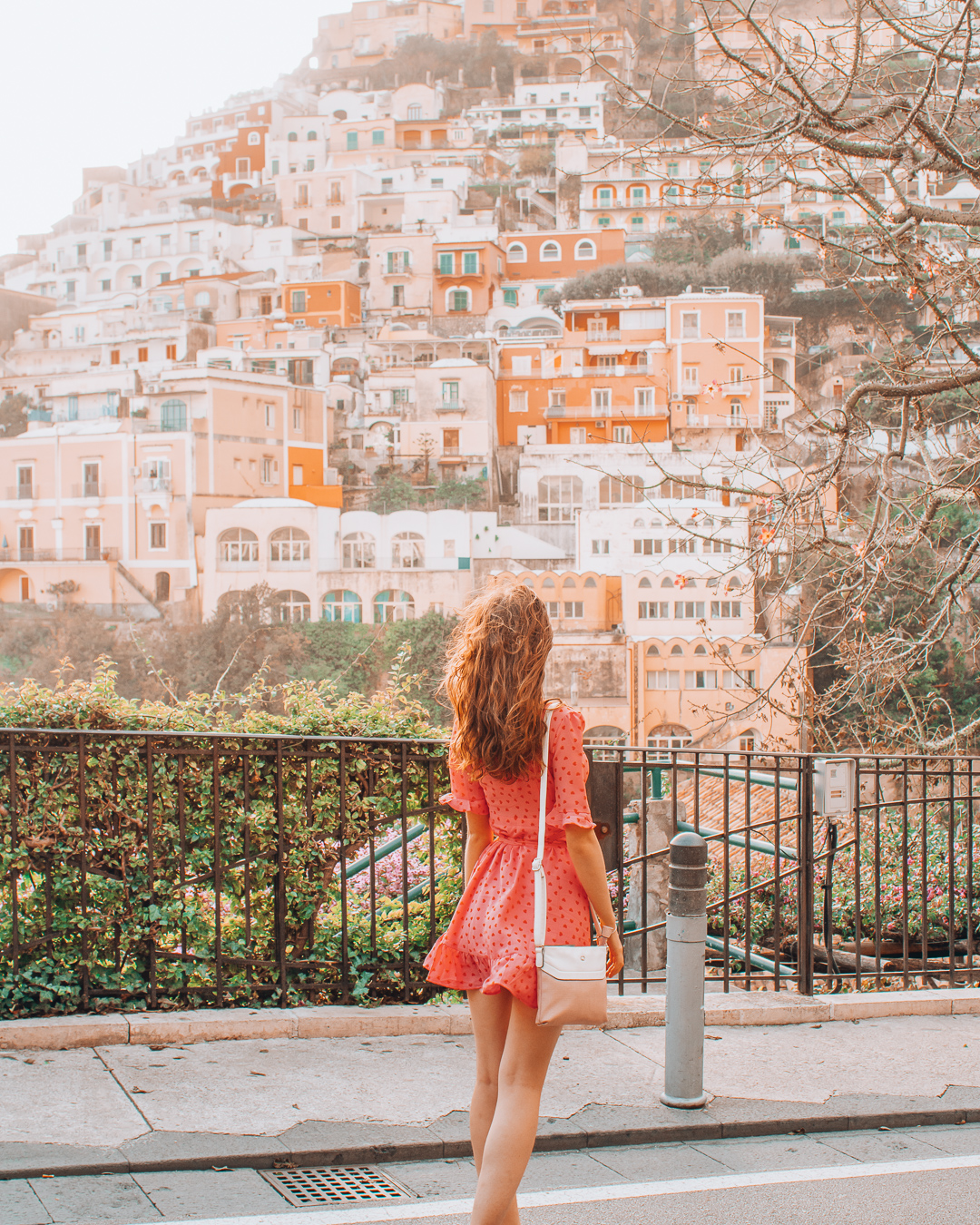 Girl looking at orange and white houses