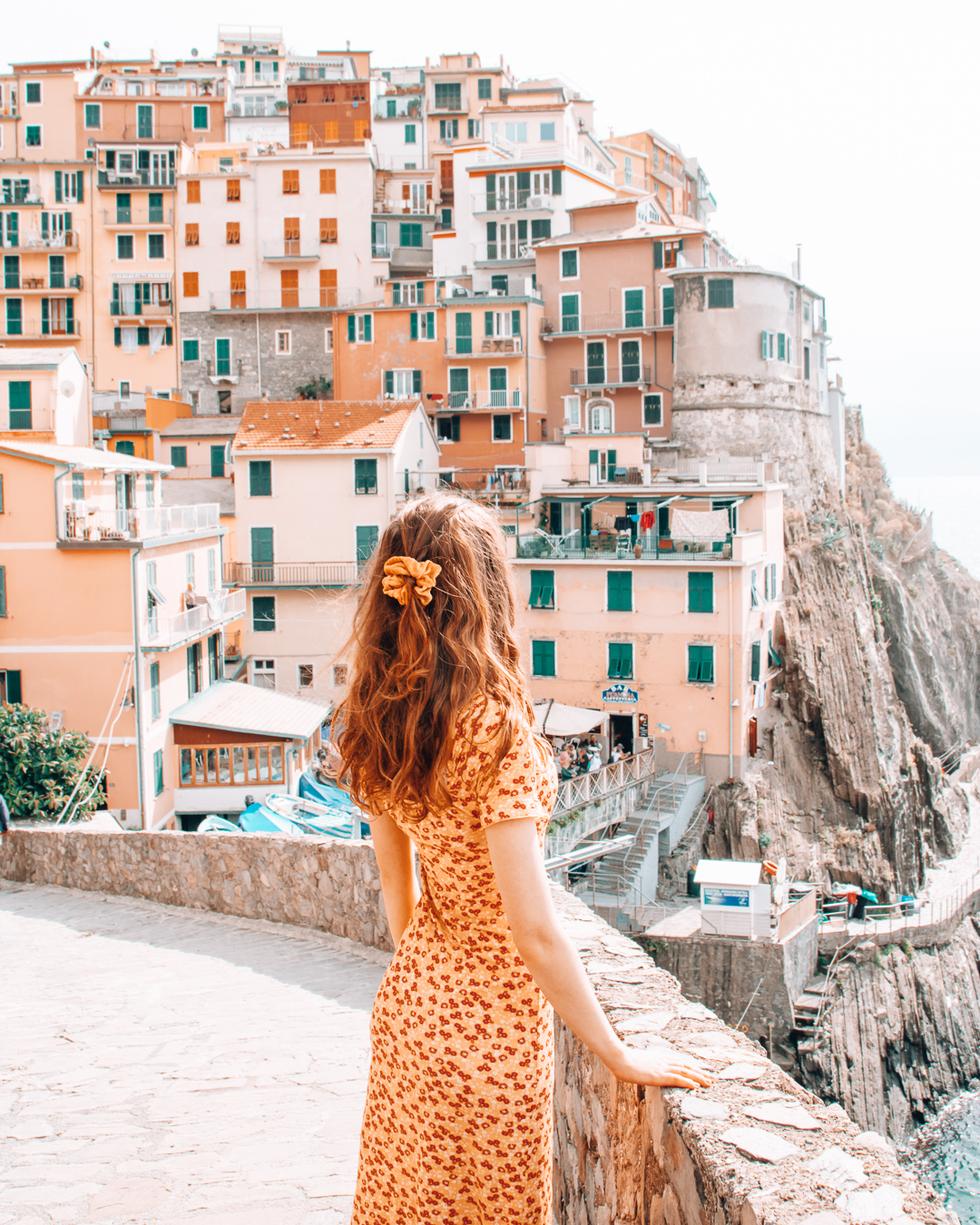 Girl looking at the houses in Manarola