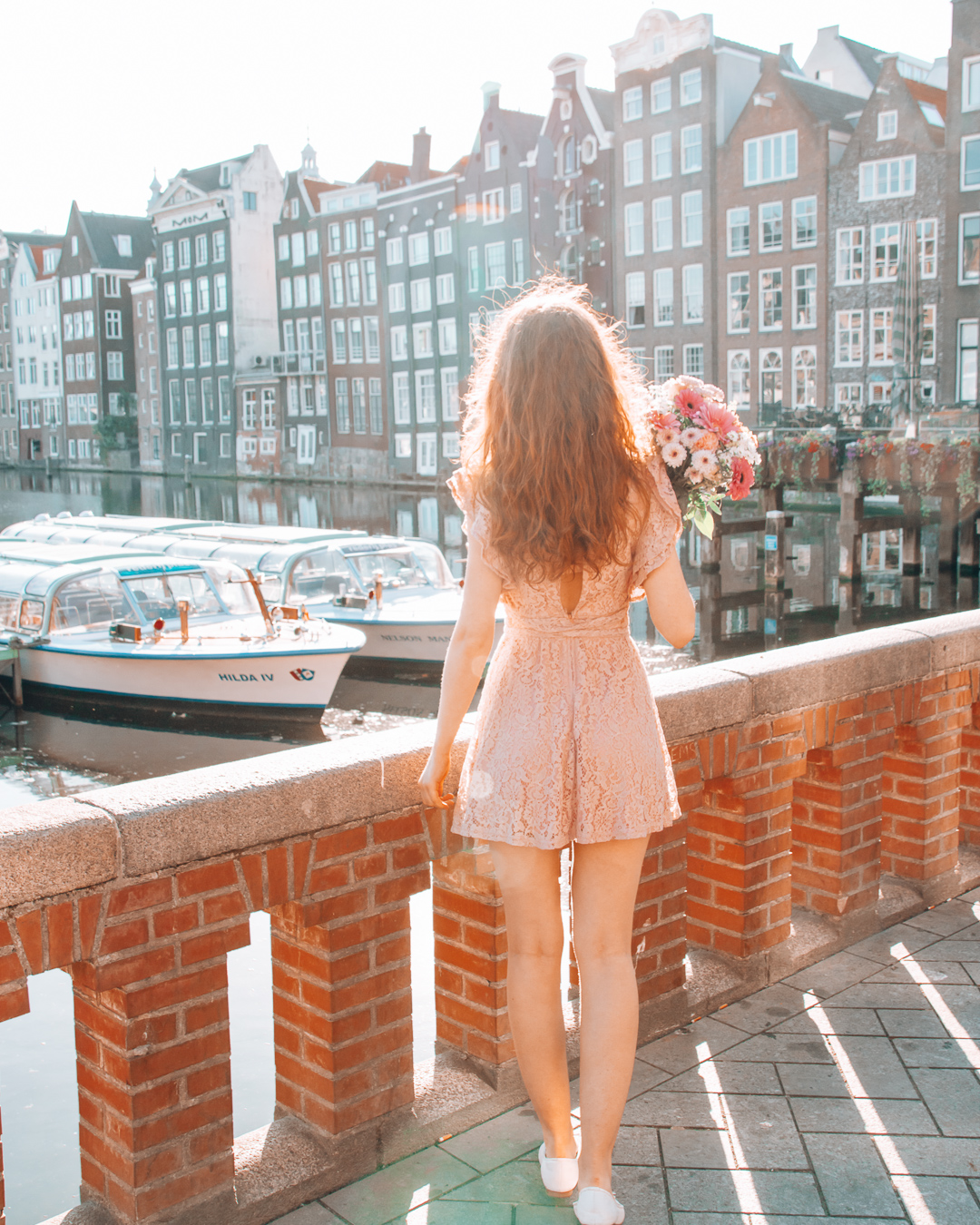 Canal cruises and houses in Amsterdam