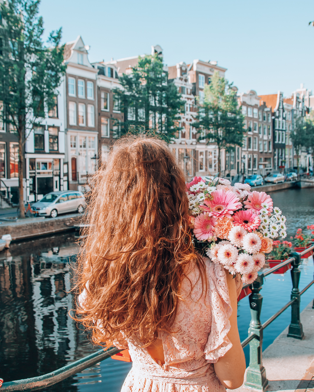 Canal in Amsterdam and a girl