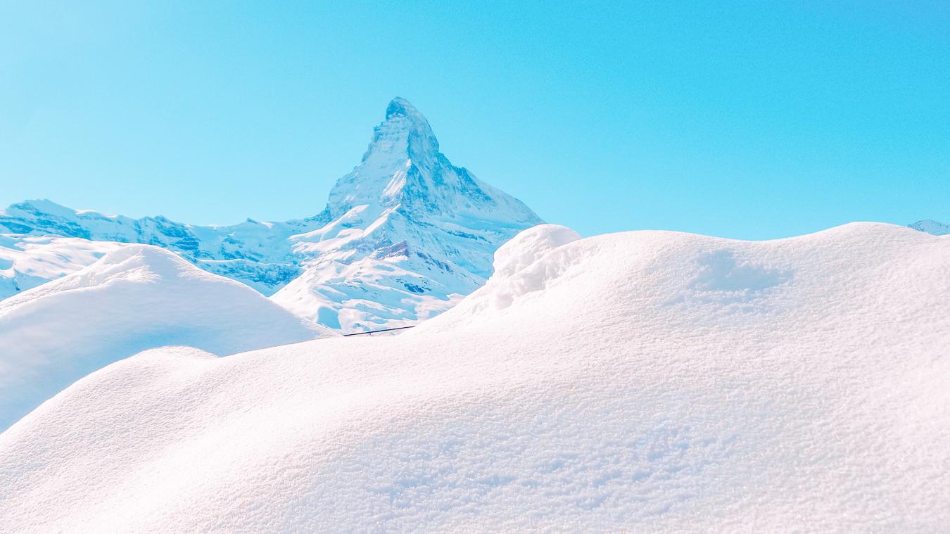 Snow, a mountain and a blue sky